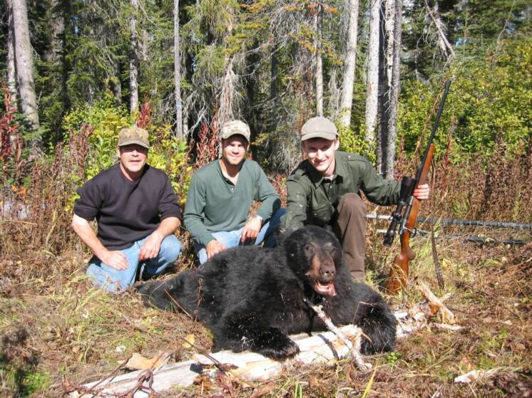 Successful black bear hunt!  Dave (outfitter), Travis (guide) and client